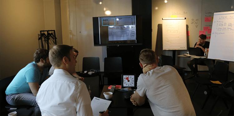 Workshop image, big screen with skype testing